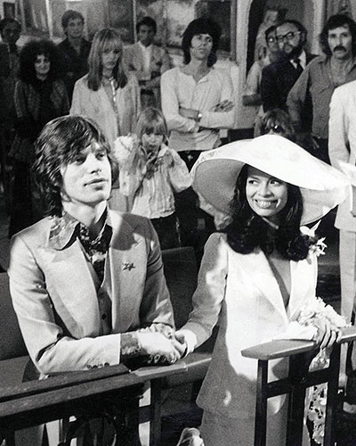 Bianca Jagger wearing white suit jacket on her wedding day